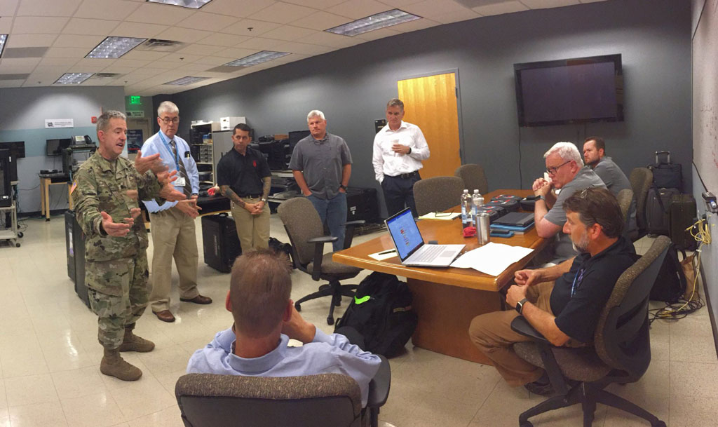 LTC(P) Harris briefs Telestration team before conducting bandwidth testing.